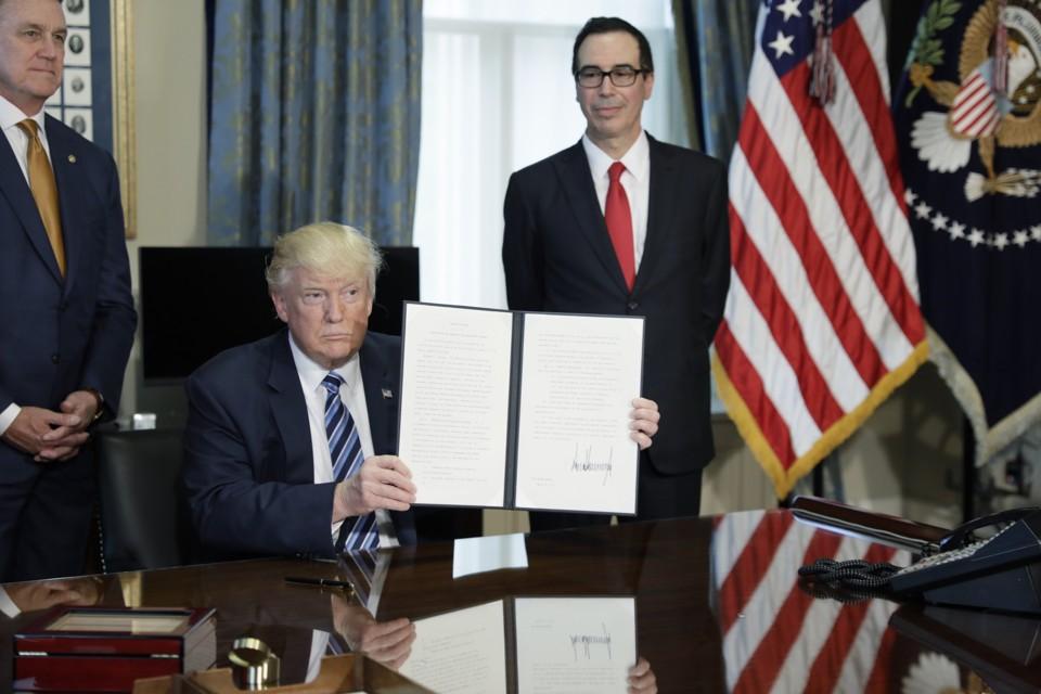 Trump Signs More Orders Targeting Wall Street Regulations