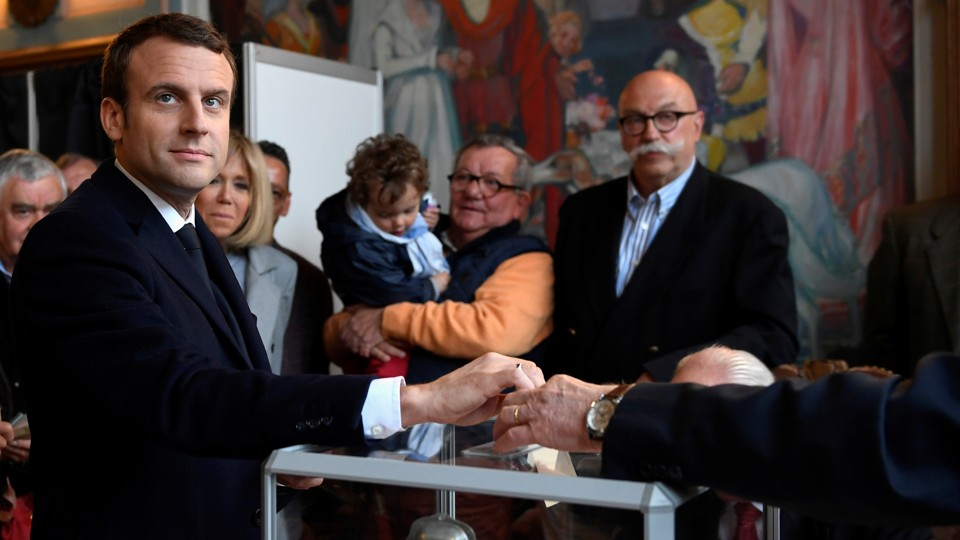 Emmanuel Macron casts his ballot in the first round of French presidential election at a polling station in Le Touquet, France onApril 23, 2017.