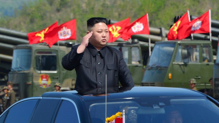 North Korea's leader Kim Jong Un watches a military drill.