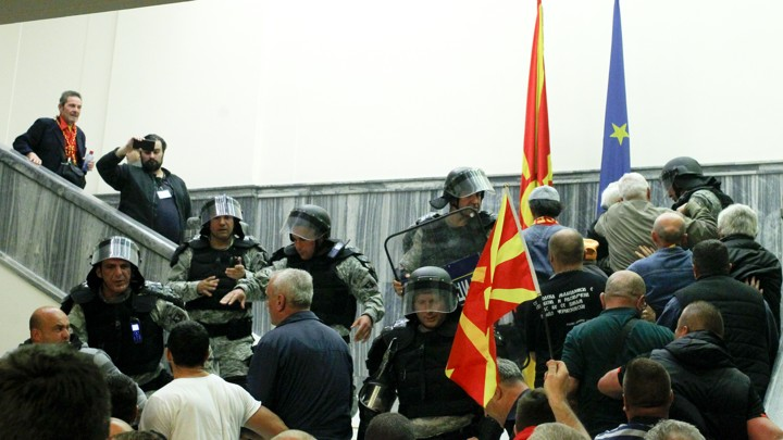 Police try to stop protesters entering Macedonia's parliament after the governing Social Democrats and ethnic Albanian parties voted to elect an Albanian as parliament speaker in Skopje, Macedonia.