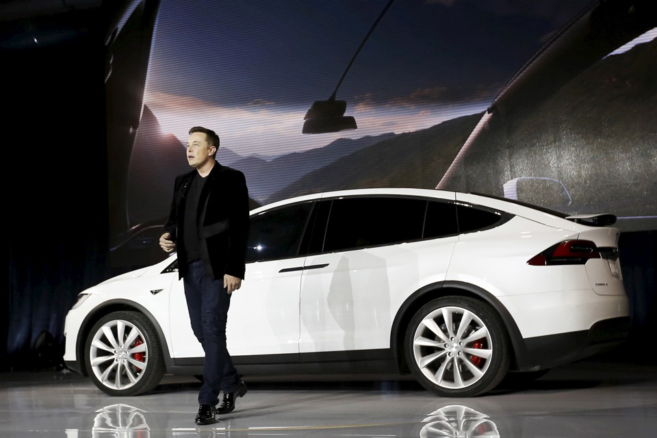 Elon Musk, the founder of Tesla, presents one of his company's cars in 2015.