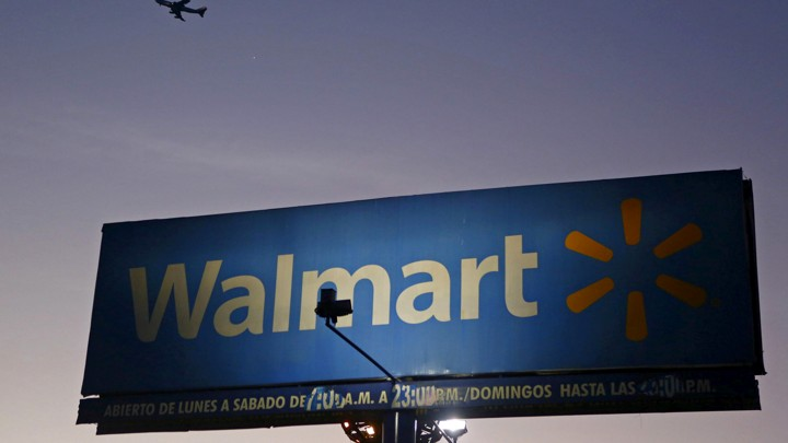 A sign advertising a Walmart store