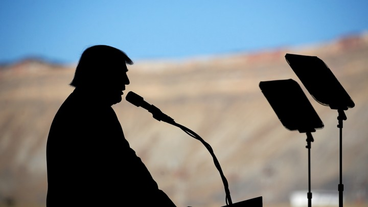 The silhouette of President Donald Trump