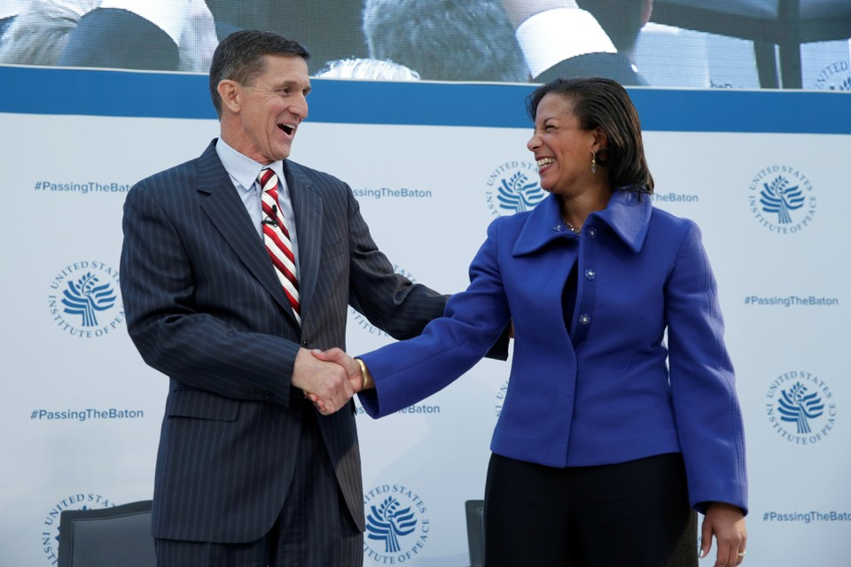 Michael Flynn and Susan Rice shake hands at a January 10 event in Washington.