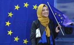 A Muslim woman holds a European flag during a pro-EU demonstration.
