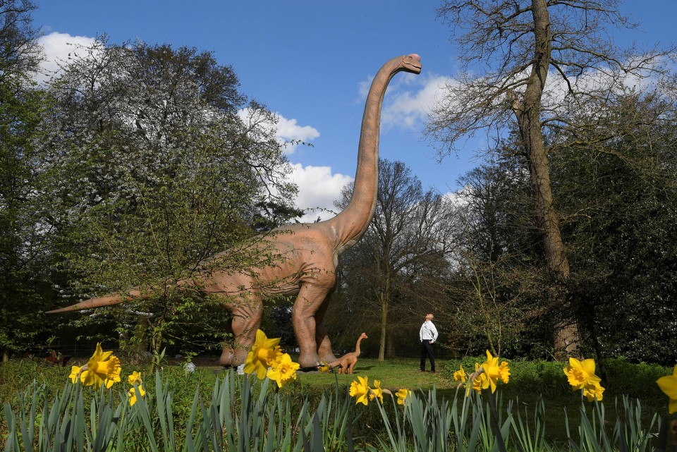 A man views an animatronic life-size dinosaur at Osterley Park in west London, in March 2017.