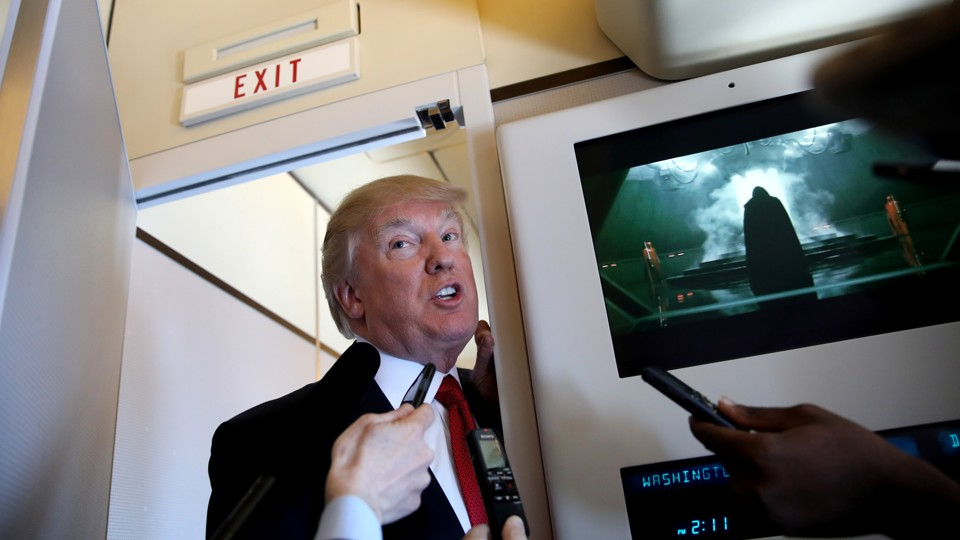 Donald Trump speaks on board Air Force One on Thursday
