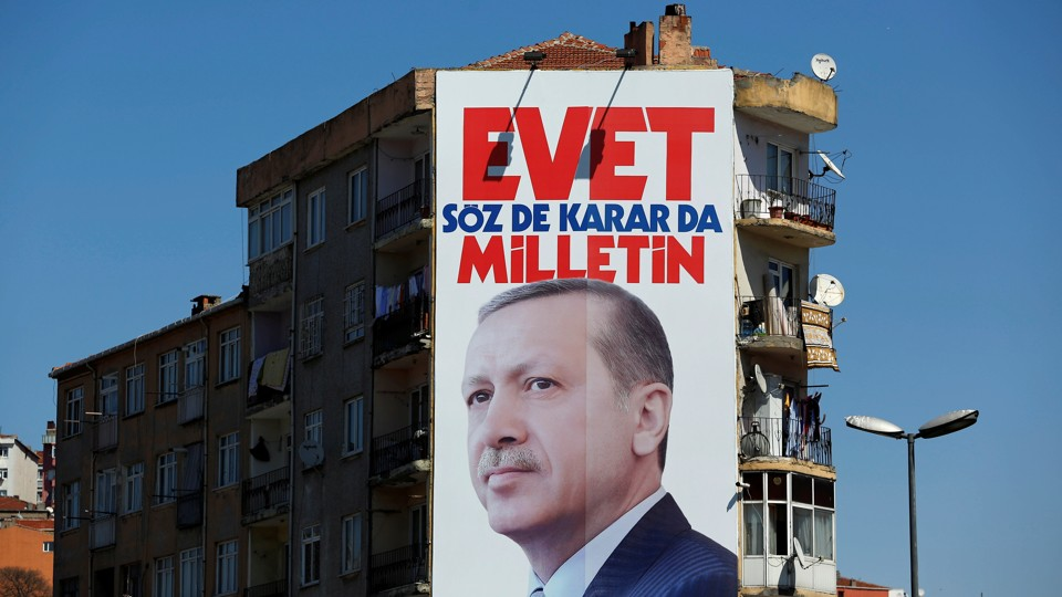 """A billboard carrying a picture of Turkish President Tayyip Erdogan and a slogan that reads: """"Yes. It is for the people to speak and to decide"""" in Istanbul"""