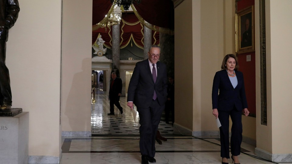 Democratic leaders Chuck Schumer and House Nancy Pelosi arrive at a news conference in Washington.
