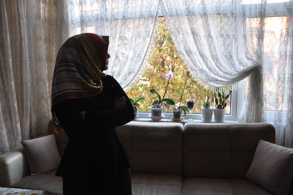 A 28-year-old Gulenist teacher who lost her job after the coup waits in her home in Turkey