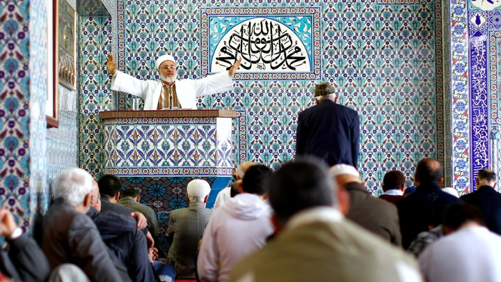An imam holds Friday prayers at the Central Mosque in the German town of Hamburg
