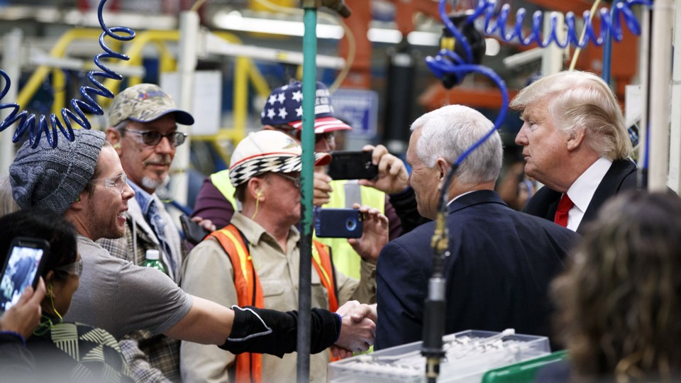 President Trump and Vice President Pence meet with workers at the Carrier  factory in Indiana Evan Vucci / AP
