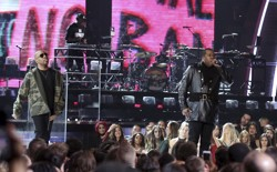 A Tribe Called Quest perform with anti-Trump imagery at the Grammys