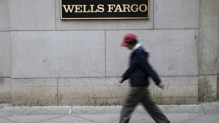 A person walks past a Wells Fargo location in Philadelphia.
