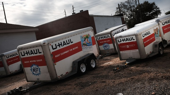 U-Haul moving trailers sit in a parking lot in Biloxi, Mississippi.
