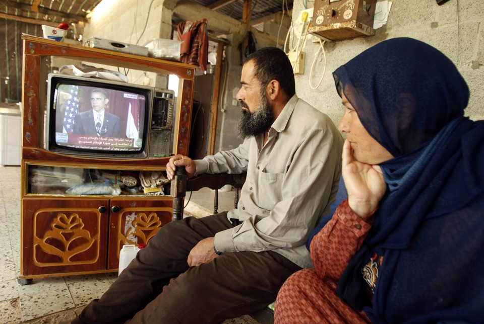 Palestinians in Khan Younis watch Barack Obama speak in Cairo on June 4, 2009.