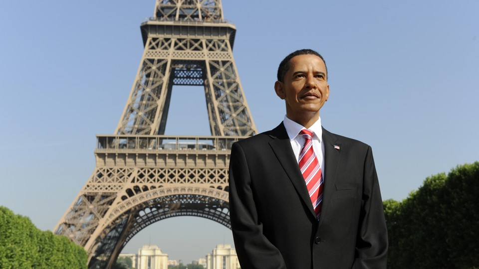 A wax statue of former President Barack Obama stands in front the Eiffel Tower before its installation at the Grevin Museum in Paris on June 29, 2009.