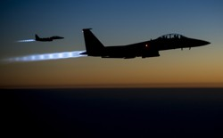 A pair of U.S. Air Force F-15E Strike Eagles fly over northern Iraq after conducting airstrikes in Syria on September 23, 2014.