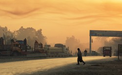 A man crosses the street near Forward Operating Base Fenty in Afghanistan's Nangarhar province on December 19, 2014.