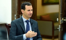 Syrian President Bashar al-Assad speaks during an interview with RIA Novosti and Sputnik in this handout picture provided by SANA on April 21, 2017.