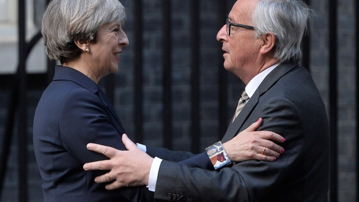 British Prime Minister Theresa May welcomes European Commission President Jean-Claude Juncker to Downing Street in London on April 26.