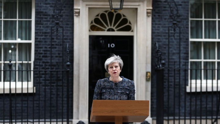Prime Minister Theresa May speaks outside 10 Downing Street after traveling to Buckingham Palace to visit Queen Elizabeth after Parliament was dissolved ahead of the general election on May 3, 2017.