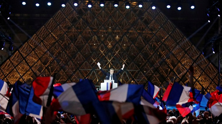 French President-elect Emmanuel Macron celebrates on the stage at his victory rally.