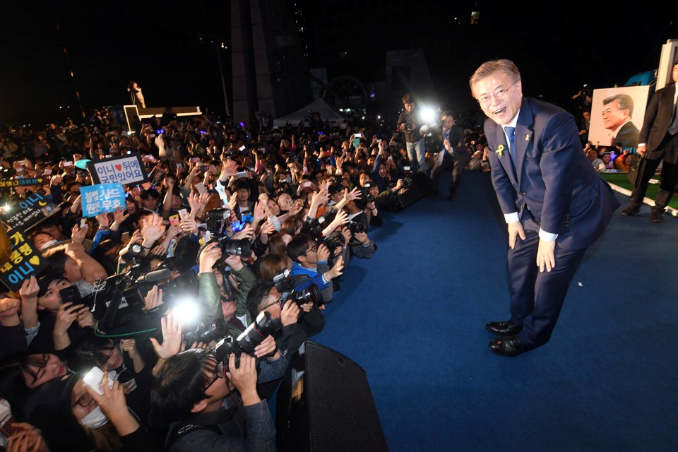South Korea's president Moon Jae-in bows to his supporters at Gwanghwamun Square in Seoul.