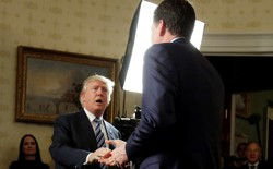 President Trump greets FBI Director James Comey at a January 22 reception.
