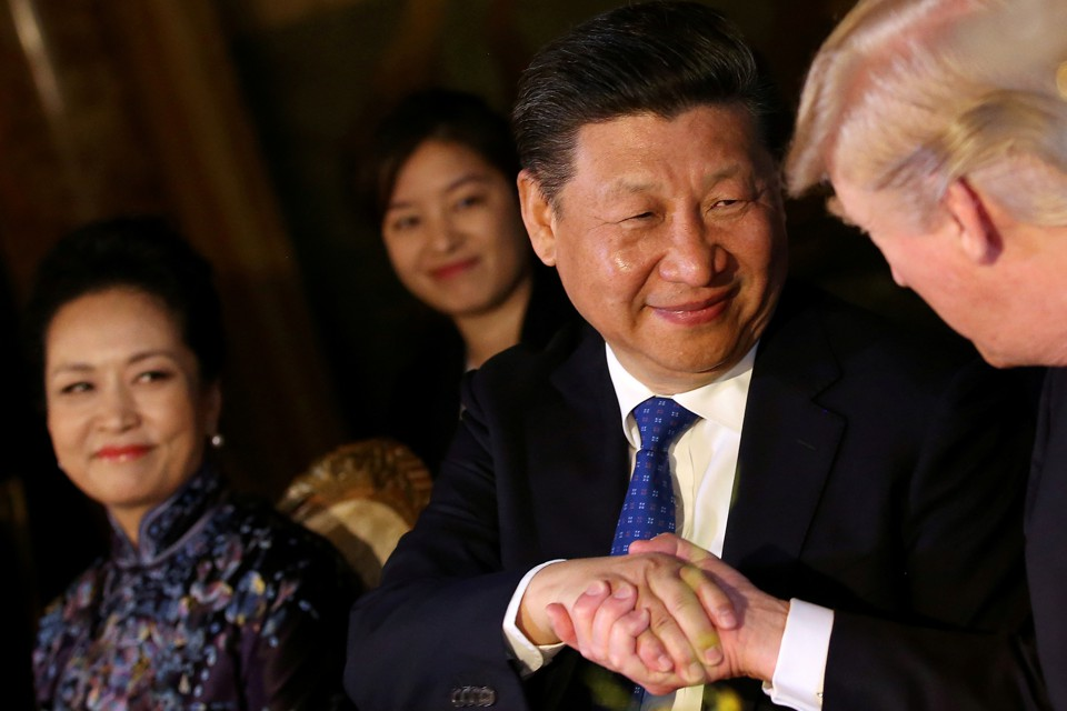 Chinese President Xi Jinping shakes hands with U.S. President Donald Trump.