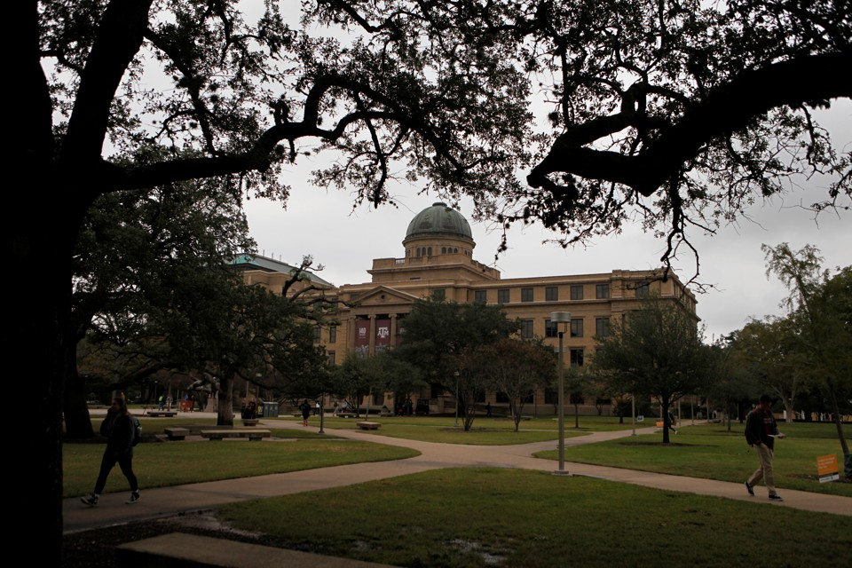 A stately university building is photographed on a slightly overcast day
