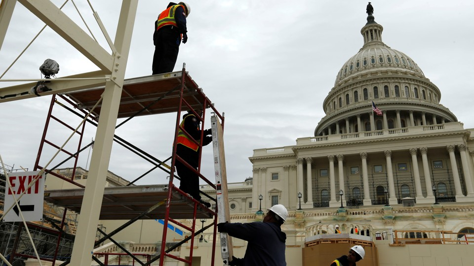 Construction workers in front of the U.S. Capitol