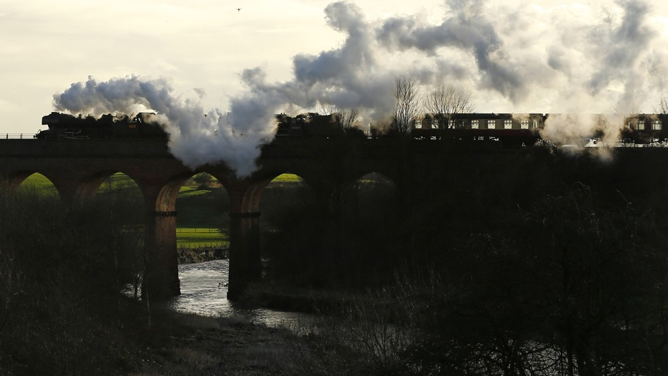 The Flying Scotsman steam engine passes over a viaduct in Bury, Britain, in 2016.