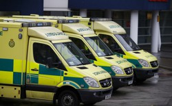 Ambulances wait outside the emergency department at the Royal University Hospital in Liverpool, England, in January 2017.
