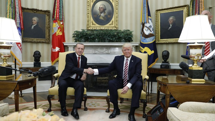 Turkey's President Recep Tayyip Erdogan shakes hands with President Trump in the Oval Office on May 16, 2017.