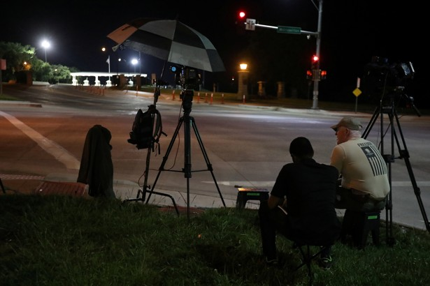 Media wait at the front gate of U.S. Army base Fort Leavenworth for the expected departure of Chelsea Manning in Leavenworth, Kansas, on May 17.