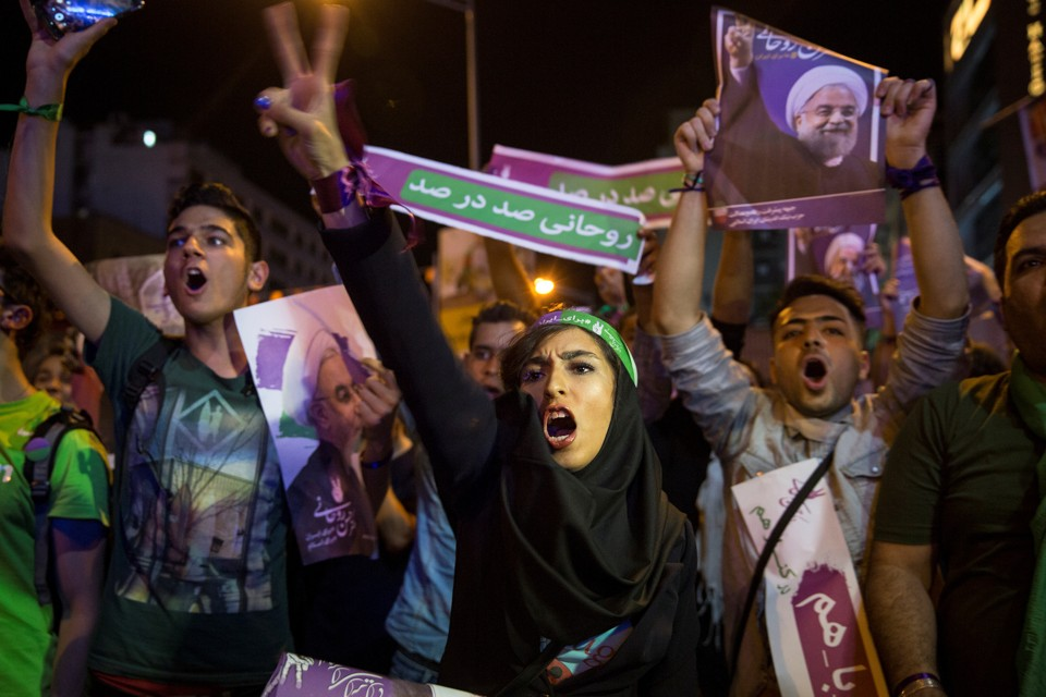 Supporters of Iran's President Hassan Rouhani take part in a campaign rally in Tehran, Iran, on May 17, 2017.