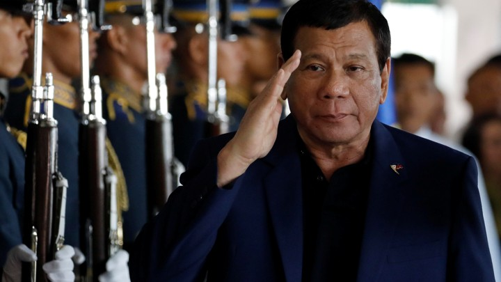 Philippine President Rodrigo Duterte salutes honor guards upon arrival from Russia at the Ninoy Aquino International airport in Manila, Philippines on May 24, 2017.