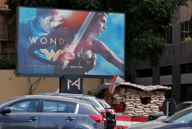 "An billboard advertising the ""Wonder Woman"" film, which was banned in Lebanon, is pictured near an army post in Beirut on May 31, 2017."