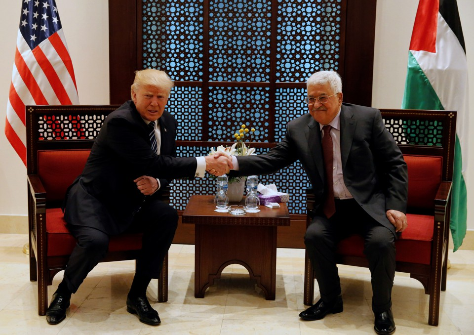 U.S. President Donald Trump shakes hands with Palestinian President Mahmoud Abbas during their meeting at the presidential headquarters in the West Bank town of Bethlehem on May 23, 2017.