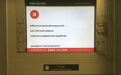 "A virus-infected screen at Ukraine's OshchadBank that says ""sorry for the inconvenience/under repair"" in Kiev on June 28, 2017."