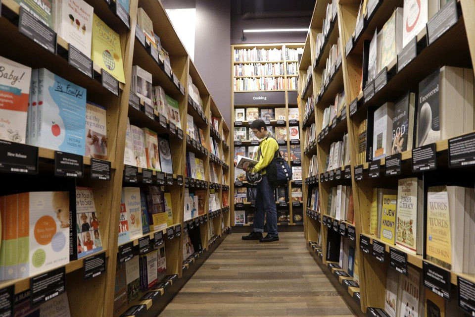 A customer browses at a book store in Seattle