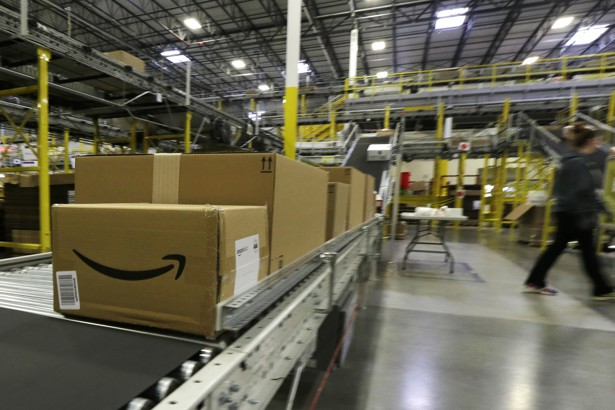 Packages on a conveyor belt at an Amazon warehouse