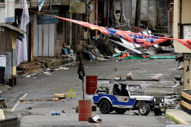An ISIS flag hangs over the Maute group stronghold in southern Philippines on May 29, 2017.