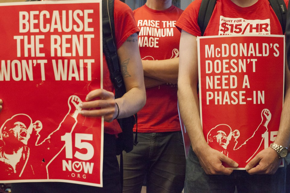 Supporters of a $15 minimum wage at a Seattle City Council meeting in June 2014