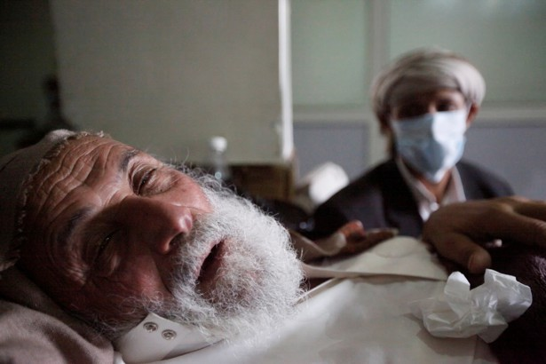 An old man infected with cholera lies on the bed at a hospital in Sanaa, Yemen on May 12, 2017.