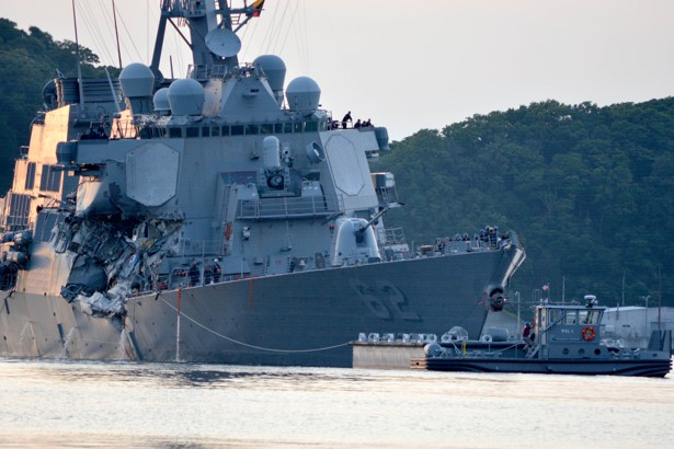 The U.S. Navy Arleigh Burke-class guided-missile destroyer USS Fitzgerald returns to base after a collision.