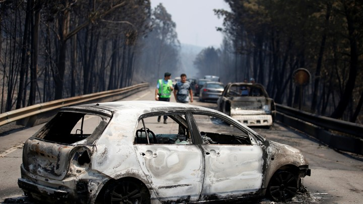Burned cars are seen during a forest fire in Figueiro dos Vinhos.