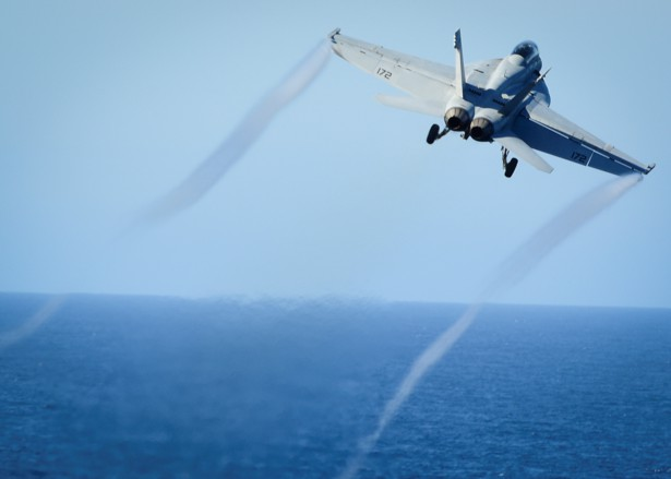 An F/A-18E Super Hornet takes off from the flight deck of the U.S. Navy aircraft carrier USS Nimitz on October 29, 2016.