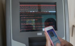 Amessage demanding money is seen on a monitor of a payment terminal at a branch of Ukraine's state-owned bank Oschadbank after Ukrainian institutions were hit by a wave of cyberattacks on June 27, 2017.